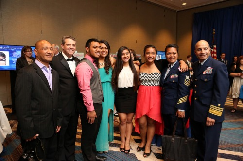Jim (second from left) with MCOY 2014 for Coast Guard Juanita Collins and family, along with VADM Manson Brown, USCG, at the 2014 MCOY gala, April 10.
