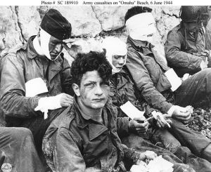 587px-Omaha_Beach_wounded_soldiers,_1944-06-06