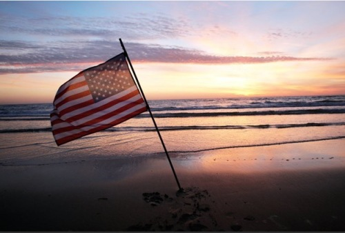 Sunrise on Omaha Beach at Normandy, France on the 70th Anniversary. June 6, 2014 (AP Photo/Thibault Camus)