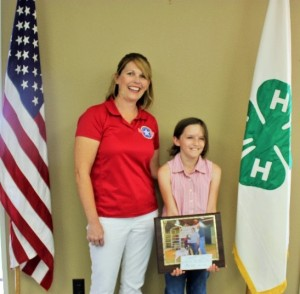 Erica Howe, Community Liaison for Operation Homefront, met Taylor at the Texas A & M AgriLife Extension Service Office to receive Taylor's gift to Operation Homefront.