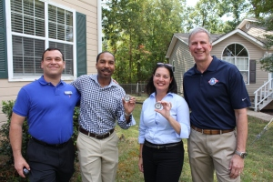 John and Operation Homefront Board of Directors member Angelo Lombardi and friends from Cracker Barrel with Operation Homefront challenge coins.
